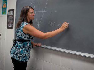 Math teacher Aimee Barkalow teaches slopes to her Calc A class.