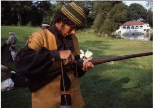 Richard Gross loads his musket.