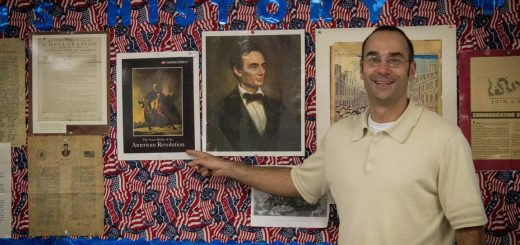 Mr. Wolf excitedly points to a photo of the American Revolution.