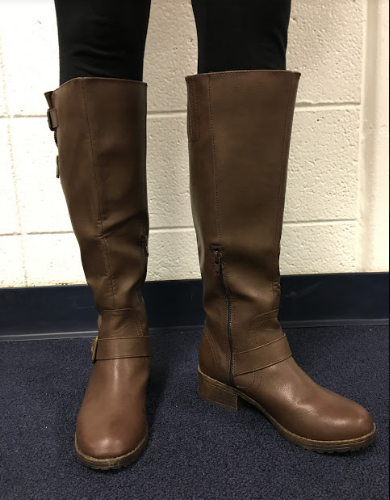 Patel's leather riding boots.