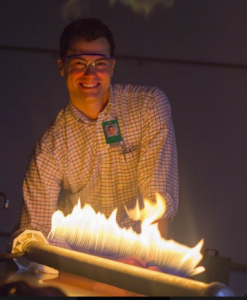 Mr. Torpe happily demonstrates waves using fire.