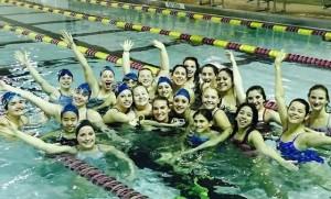 Swim team smiles at practice