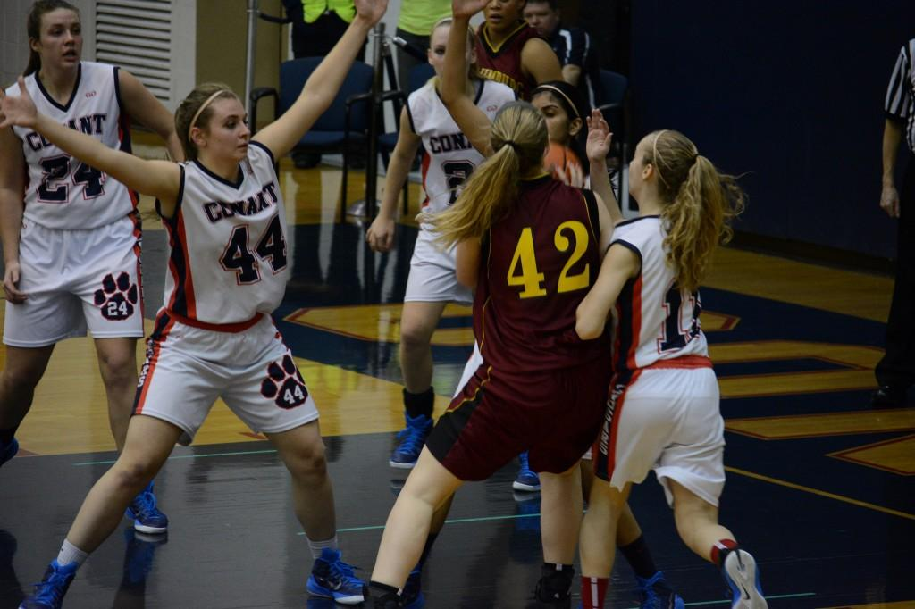 The girls defense swarms the Schaumburg player as she tries to attack the paint.