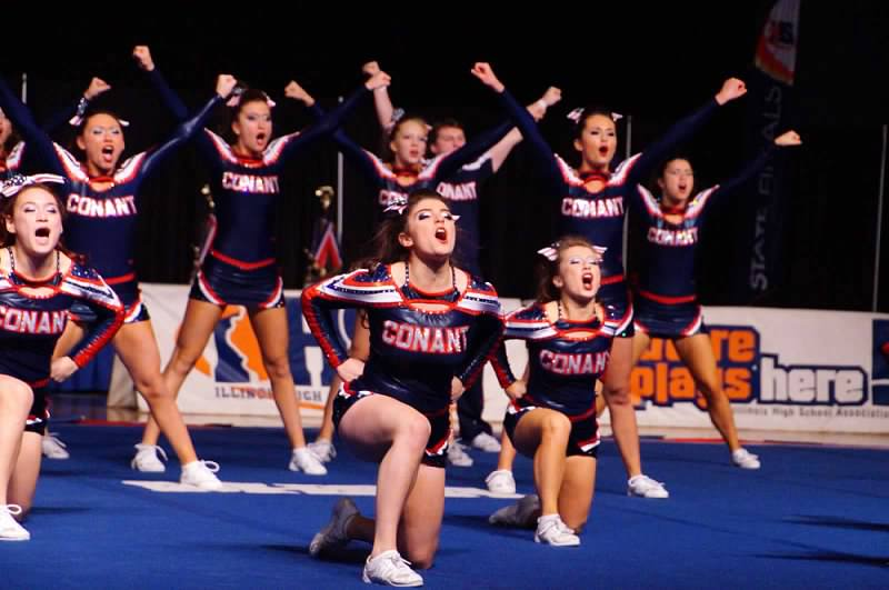 Conant's varsity co-ed cheerleaders perform at IHSA state competition. competition.