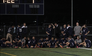 This picture includes the Varsity boys soccer team at their final game this season