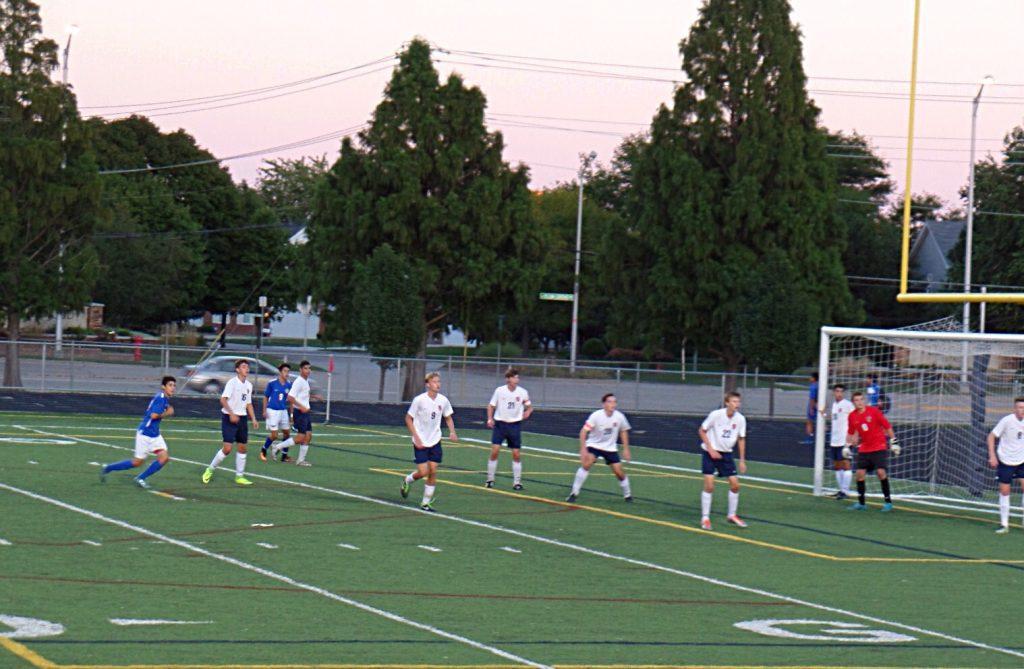The defense prepares for a Hoffman corner kick.
