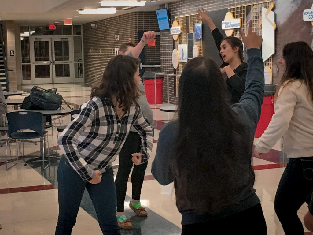"Nicholson gets the new members dancing during game ""Left Right Left"" where people on the outside mimic the person in the middle. Nicholson says ""This is a great and positive way to get everybody involved,"" and third year participant Juhi Shah, '17, says that ""we hold promotional events all the time leading up to the retreat on February 18 and new members are always welcome."""