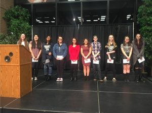 Students receive their awards at the Harper Art Show