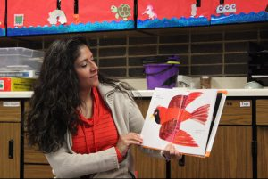 Mrs. Candia reads her favorite book to her preschool class.