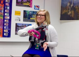 Ms. Wozniak plans a fun activity involving the tambourine.