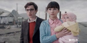 (from left to right) Klaus, Violet and Sunny Baudelaire react to hearing their parents have died.