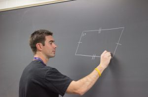 Mr. Melone teaches his students about angles and parallelograms.